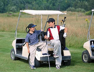 kids on a golf cart