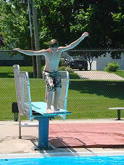 kid on diving board